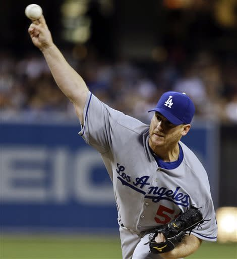Los Angeles Dodgers starting pitcher Chad Billingsley works against the San Diego Padres during the first inning of a baseball game in San Diego, Wednesday, April 10, 2013. (AP Photo/Lenny Ignelzi)