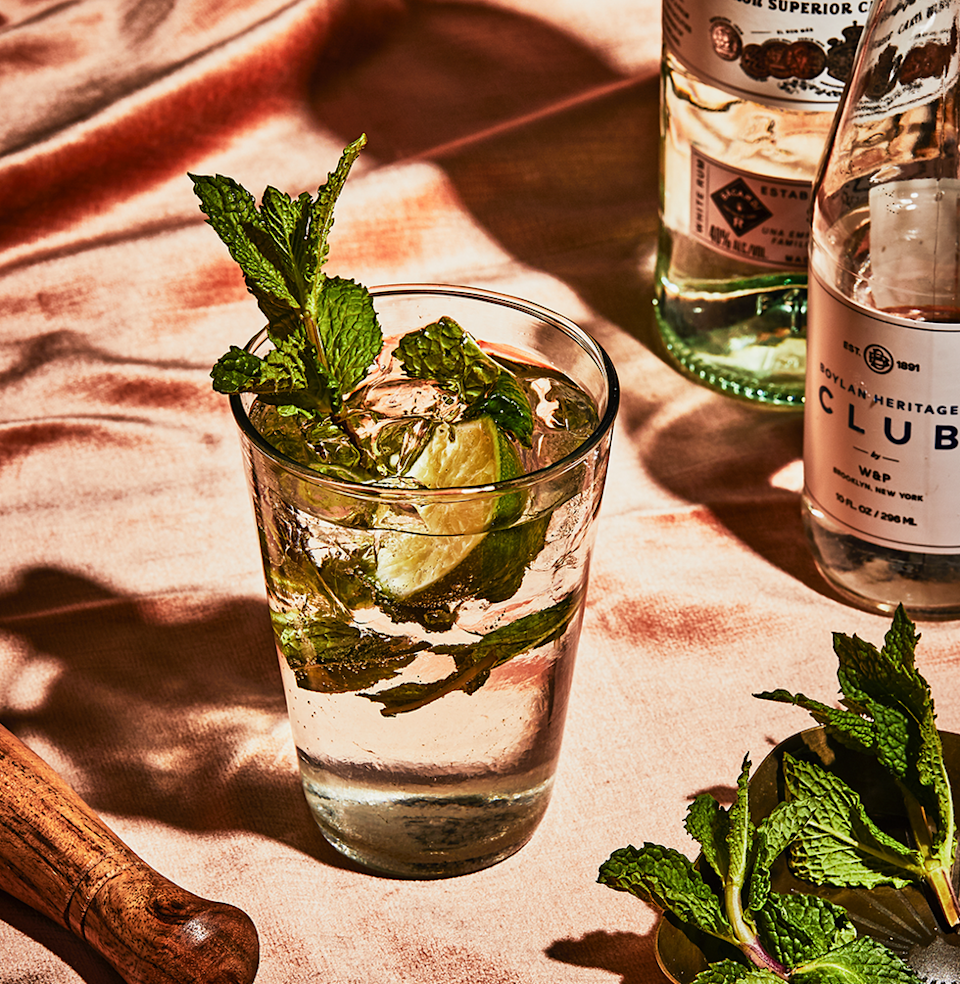 """<p><em>This recipe is a good one to memorize; if you can make a Mojito like it's second nature, you'll be able to impress anyone.</em></p><p><strong>Ingredients</strong></p><p>• 2 oz. white rum<br>• 1/2 oz. lime juice (squeezed fresh)<br>• 1 tsp. superfine sugar<br>• 3 mint leaves<br>• club soda or seltzer </p><p><strong>Directions</strong></p><p>In a smallish Collins glass, muddle lime juice with 1/2 to 1 tsp. superfine sugar. Add the mint leaves, mushing them against the side of the glass. Fill glass 2/3 with cracked ice and pour in the rum. Pitch in the squeezed-out lime shell and top off with club soda or seltzer.</p><p><a class=""""link rapid-noclick-resp"""" href=""""https://www.esquire.com/food-drink/drinks/recipes/a3837/mojito-drink-recipe/"""" rel=""""nofollow noopener"""" target=""""_blank"""" data-ylk=""""slk:Read More"""">Read More</a></p>"""