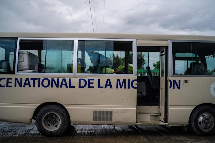 A bus at the airport in Port-au-Prince, Haiti, for deportees returned to Haiti by the United States on Sunday, Sept. 19, 2021. (Federico Rios/The New York Times)