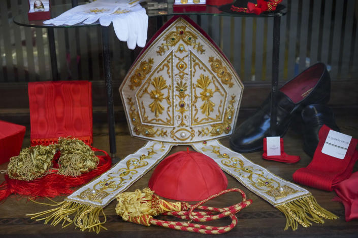 Cardinal clothing accessories are seen on display in the window of the Gammarelli clerical clothing shop, in Rome, Thursday, Nov. 26, 2020. The consistory to elevate new cardinals scheduled for Saturday, Nov. 28, in the time of coronavirus is like nothing the Holy See has ever seen. A handful of soon-to-be cardinals are in protective coronavirus quarantine, including African-American, Cardinal-designate Wilton Gregory, archbishop of Washington who explained that a U.S.-based ecclesiastical tailor took his measurements while he was still in Washington and sent them to Gammarelli, which then made them to order and sent them to Santa Marta hotel where he is undergoing the quarantine. (AP Photo/Andrew Medichini)