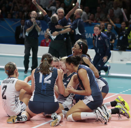 United States' team celebrates after winning the women's Volleyball World Championships final match against China in Milan, Italy, Sunday, Oct. 12, 2014. (AP Photo/Emilio Andreoli)