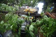 MUMBAI, INDIA - JUNE 03: A view of a tree fell on vehicles due to strong winds triggered by Cyclone Nisarga in Mumbai, India on June 03, 2020. A storm in the Arabian Sea off India's west coast intensified into a severe cyclone on Wednesday, gathering speed as it barreled toward India's financial capital of Mumbai. Nisarga was forecast to drop heavy rains and winds gusting up to 120 kilometers (75 miles) per hour when it makes landfall Wednesday afternoon as a category 4 cyclone near the coastal city of Alibagh, about 98 kilometers (60 miles) south of Mumbai, India's Meteorological Department said. (Photo by Imtiyaz Shaikh/Anadolu Agency via Getty Images)