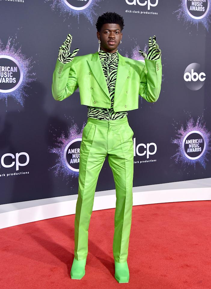 Lil Nas X continued his work as the year's most stylish celebrity pairing a neon green suit with a matching zebra-print turtleneck and gloves. A look!