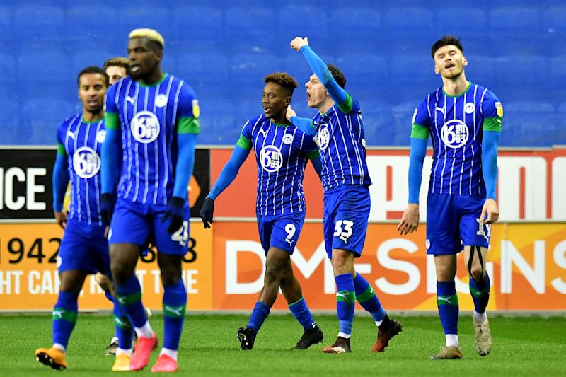 Wigan Athletic's Jamal Lowe celebrates scoring his side's second goal of the game