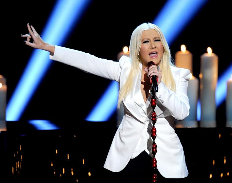 LOS ANGELES, CA - JANUARY 09:  Singer Christina Aguilera performs onstage at the 39th Annual People's Choice Awards  at Nokia Theatre L.A. Live on January 9, 2013 in Los Angeles, California.  (Photo by Kevin Winter/Getty Images for PCA)