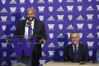 Washington NCAA college football defensive coordinator Jimmy Lake, left, speaks about taking over the head coaching position from Chris Petersen, right, during a news conference, Tuesday, Dec. 3, 2019, in Seattle. Petersen unexpectedly resigned on Monday, a shocking announcement with the Huskies coming off a 7-5 regular season and bound for a sixth straight bowl game under his leadership. Petersen will coach Washington in a bowl game, his final game in charge. (AP Photo/Elaine Thompson)