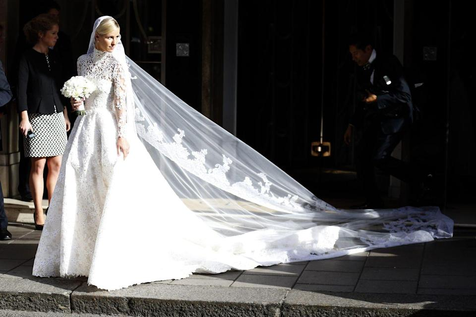 <p>Nicky Hilton channeled her inner-Grace Kelly in a high-neck lace Valentino gown for her wedding to James Rothschild in London.</p>