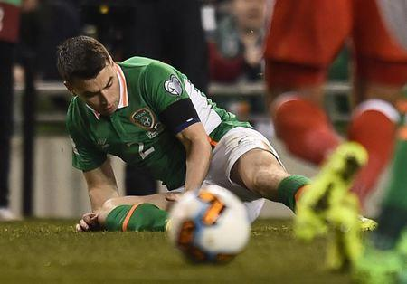 Republic of Ireland's Seamus Coleman lies injured