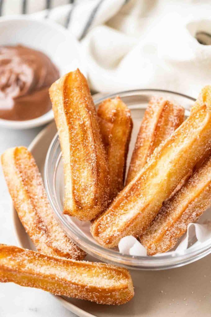 """<p>Normally, you need a pot of hot oil to make nice crispy churros, but you can use your air fryer to get a similar effect. Be sure to serve with a nice chocolate sauce for dipping!</p><p><strong>Get the recipe at <a href=""""https://platedcravings.com/air-fryer-churros/"""" rel=""""nofollow noopener"""" target=""""_blank"""" data-ylk=""""slk:Plated Cravings"""" class=""""link rapid-noclick-resp"""">Plated Cravings</a>.</strong></p><p><a class=""""link rapid-noclick-resp"""" href=""""https://go.redirectingat.com?id=74968X1596630&url=https%3A%2F%2Fwww.walmart.com%2Fsearch%2F%3Fquery%3Dpioneer%2Bwoman%2Bmixing%2Bbowls&sref=https%3A%2F%2Fwww.thepioneerwoman.com%2Ffood-cooking%2Fmeals-menus%2Fg37257771%2Fair-fryer-desserts%2F"""" rel=""""nofollow noopener"""" target=""""_blank"""" data-ylk=""""slk:SHOP MIXING BOWLS"""">SHOP MIXING BOWLS</a></p>"""