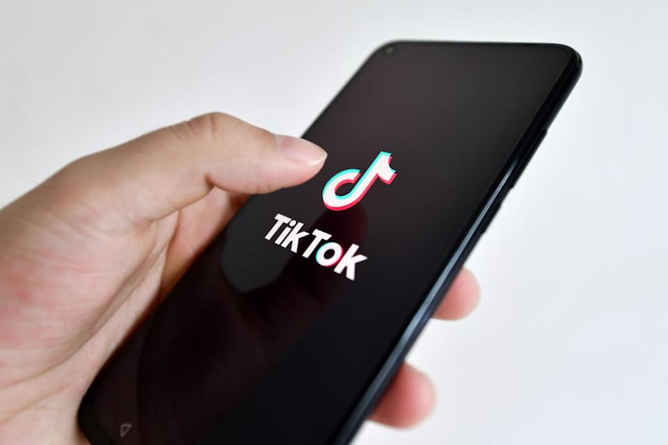 HAIKOU, CHINA - 2020/08/20: In this photo illustration, a TikTok logo seen displayed on a smartphone.The US' clampdown on TikTok along with President Donald Trump publicly favoring Oracle as the app's potential buyer are prompting concerns that the competitive landscape and innovation in the US tech industry will be harmed. (Photo Illustration by Sheldon Cooper/SOPA Images/LightRocket via Getty Images)