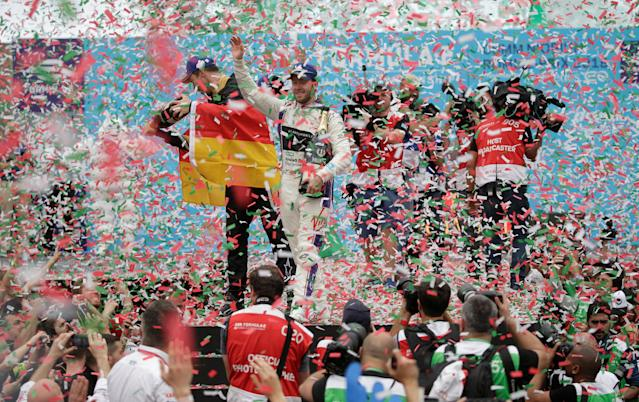 Motor Racing - Formula E - Rome ePrix - Rome, Italy - April 14, 2018 DS Virgin Racing's Sam Bird celebrates winning the race with third place Techeetah's Andre Lotterer (L) during the podium ceremony REUTERS/Max Rossi