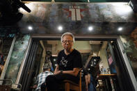 In this Oct. 9, 2020 photo, owner Grace Ma poses for a photo at her bar Club 71 in Central, a business district of Hong Kong. Nearly 15 years ago, the bar known as a gathering place for pro-democracy activists and intellectuals is closing. Ma blames government-mandated bar closures and coronavirus restrictions for its financial strain. (AP Photo/Kin Cheung)