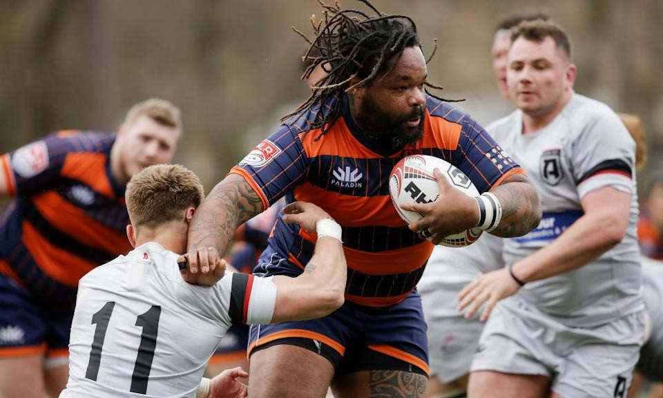 New York's France centre Mathieu Bastareaud breaks a tackle by Atlant's Austin White in Marietta, Georgia in February this year.