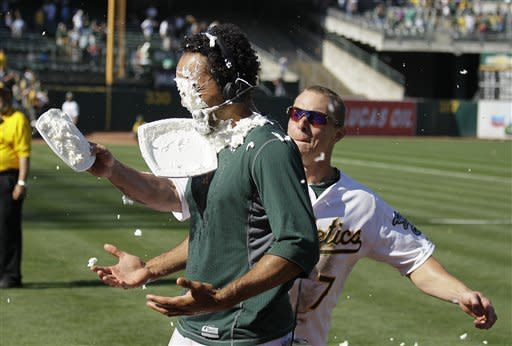 Oakland Athletics' Coco Crisp, left, is hit with a shaving cream pie by teammate Brandon Inge at the end of their baseball game against the New York Yankees Sunday, July 22, 2012 in Oakland, Calif. Oakland won the game 5-4 to sweep their four-game series. Crisp drove in the game-winning run. (AP Photo/Eric Risberg)