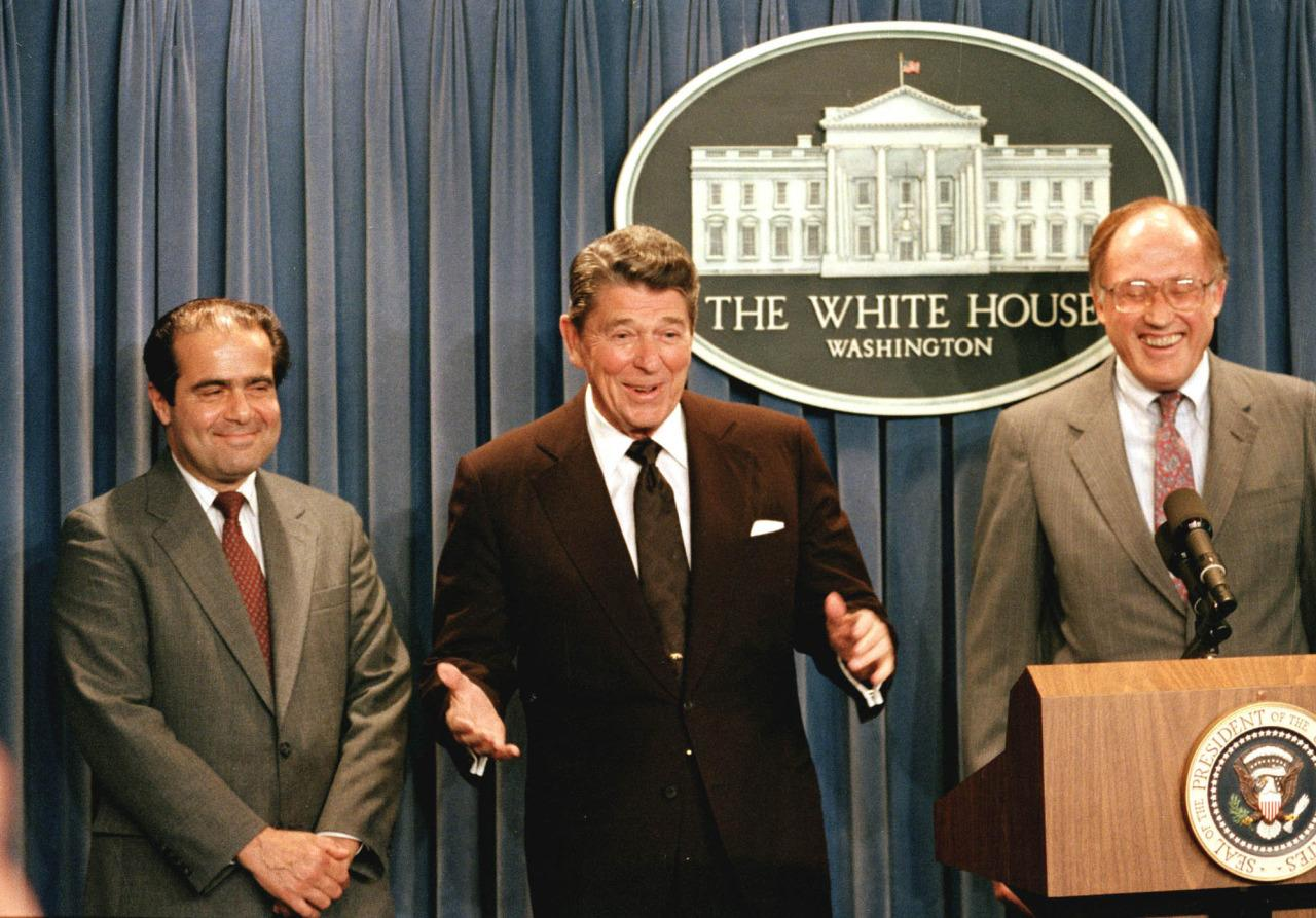 <p>President Ronald Reagan, center, gestures during a news conference at the White House June 17, 1986 , where he announced the nomination of Antonin Scalia, left, to the Supreme Court. Chief Justice William Rehnquist is at right.  <i>(Photo: Ron Edmonds/AP)</i></p>