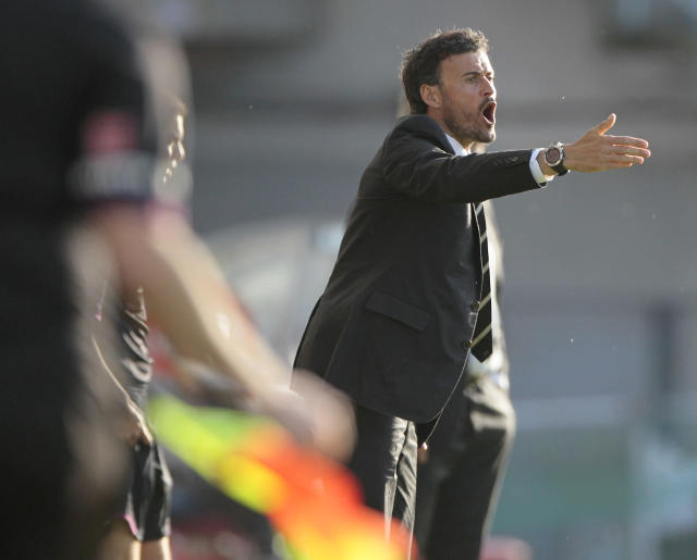 In this photo taken on Sunday, May 11, 2014, Celta's coach Luis Enrique gestures during a Spanish La Liga soccer match at the Balaidos stadium in Vigo, Spain. Barcelona hired Luis Enrique as its new coach on Monday, hoping the former player can help restore the club's recent success following its first season in six years without a major trophy. (AP Photo/Lalo R. Villar)
