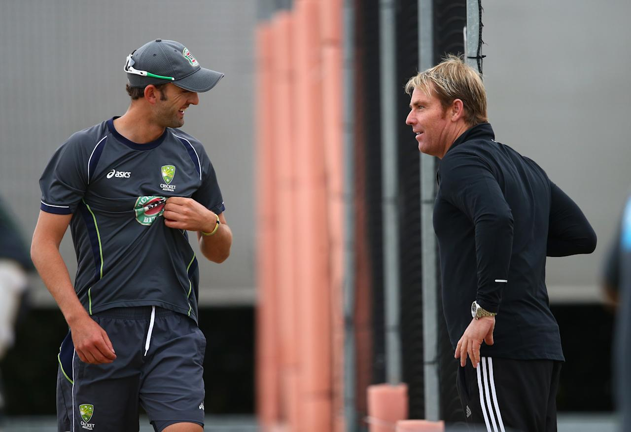 MANCHESTER, ENGLAND - JULY 31:  Former Australian Bowler Shane Warne and Nathan Lyon of Australia talk during an Australian Nets Session at Old Trafford on July 31, 2013 in Manchester, England.  (Photo by Ryan Pierse/Getty Images)
