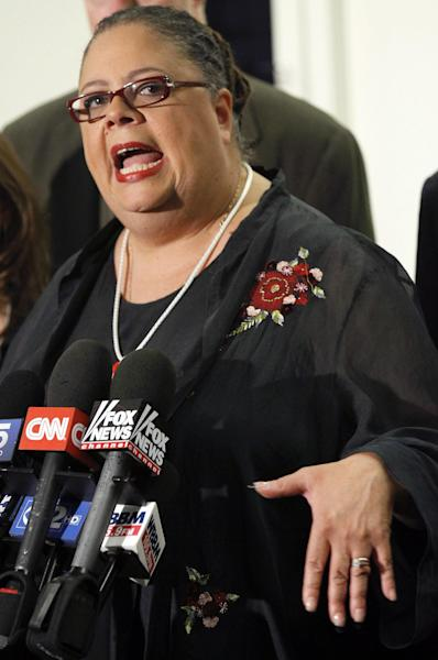 """Karen Lewis, president of the Chicago teachers union responds to a question after meeting of the union's House of Delegates Friday, Sept. 14, 2012, in Chicago. Lewis told the delegates that a """"framework"""" was in place to end the teachers strike. (AP Photo/Charles Rex Arbogast)"""