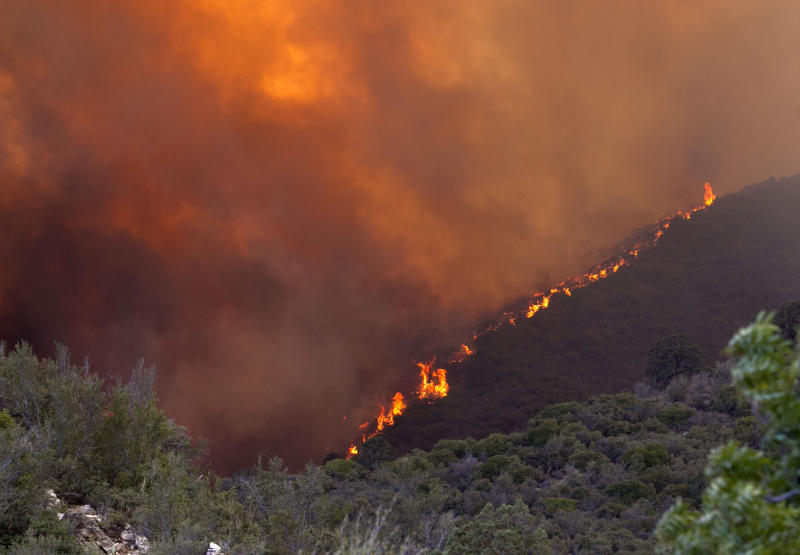 The Gladiator Fire burns in the Bradshaw Mountains in Prescott National Forest, Ariz. on Wednesday, May 16, 2012. Authorities are worried that flames from the Gladiator Fire will get past a fire line that's about a mile west of the historic mining town of Crown King, fire incident spokeswoman Loretta Benavidez said Tuesday night.  (AP Photo/The Arizona Republic, David Wallace)  MARICOPA COUNTY OUT; MAGS OUT; NO SALES