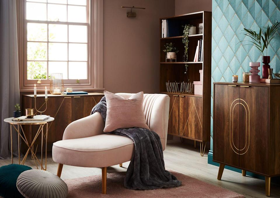 """<p>With an Art Deco influence, this trend perfectly balances rich colours with opulent textures. The highlight here is the <a href=""""https://www.homebase.co.uk/chaise-longue-dark-blush_p563942"""" rel=""""nofollow noopener"""" target=""""_blank"""" data-ylk=""""slk:Occasional Chaise Lounge Sofa"""" class=""""link rapid-noclick-resp"""">Occasional Chaise Lounge Sofa</a> in blush for only £150 (isn't it gorgeous?!) and the <a href=""""https://www.homebase.co.uk/moscow-sideboard-wood-effect-and-gold_p525338"""" rel=""""nofollow noopener"""" target=""""_blank"""" data-ylk=""""slk:Moscow Wood Effect Sideboard"""" class=""""link rapid-noclick-resp"""">Moscow Wood Effect Sideboard</a> for £85. We love the matching <a href=""""https://www.homebase.co.uk/moscow-bookcase-dark-wood-effect-with-gold_p565126"""" rel=""""nofollow noopener"""" target=""""_blank"""" data-ylk=""""slk:bookcase"""" class=""""link rapid-noclick-resp"""">bookcase</a> (£96, used to be £120) and <a href=""""https://www.homebase.co.uk/moscow-dark-wood-drinks-cabinet_p568942"""" rel=""""nofollow noopener"""" target=""""_blank"""" data-ylk=""""slk:drinks cabinet"""" class=""""link rapid-noclick-resp"""">drinks cabinet</a> (£100), too. </p>"""