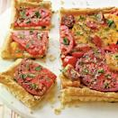 """<p><strong>Recipe: </strong><a href=""""https://www.southernliving.com/syndication/herbed-tomato-tart"""" rel=""""nofollow noopener"""" target=""""_blank"""" data-ylk=""""slk:Herbed Tomato Tart"""" class=""""link rapid-noclick-resp""""><strong>Herbed Tomato Tart</strong></a></p> <p>If you've had a rogue package of puff pastry sitting in your freezer for too long, here's exactly what to do with it.</p>"""