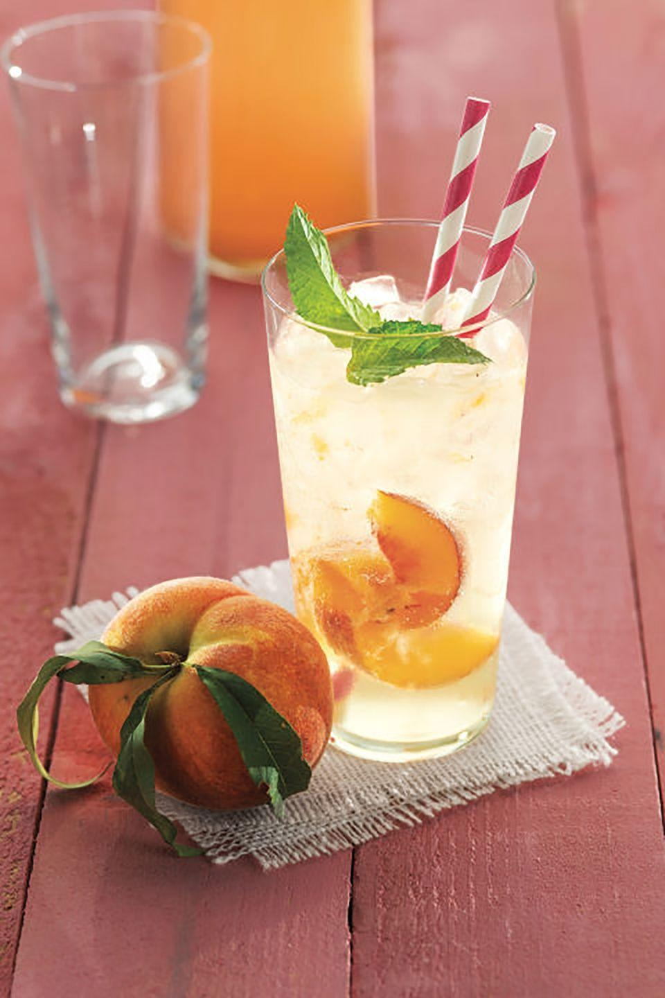 """<p>Kids will love sipping on this sweet, refreshing drink during your Memorial Day festivities, while adults will enjoy adding a splash of rum for added kick.</p><p><strong><a href=""""https://www.countryliving.com/food-drinks/recipes/a4421/ginger-peach-soda-recipe-clv0613/"""" rel=""""nofollow noopener"""" target=""""_blank"""" data-ylk=""""slk:Get the recipe"""" class=""""link rapid-noclick-resp"""">Get the recipe</a>.</strong> </p><p><a class=""""link rapid-noclick-resp"""" href=""""https://www.amazon.com/Hiware-200-Pack-Biodegradable-Paper-Straws/dp/B07D7L5Z85?tag=syn-yahoo-20&ascsubtag=%5Bartid%7C10050.g.3290%5Bsrc%7Cyahoo-us"""" rel=""""nofollow noopener"""" target=""""_blank"""" data-ylk=""""slk:SHOP STRAWS"""">SHOP STRAWS</a> </p>"""