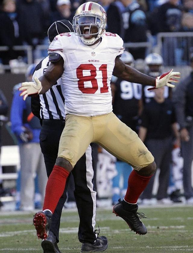 San Francisco 49ers wide receiver Anquan Boldin (81) celebrates a catch against the Carolina Panthers during the second half of a divisional playoff NFL football game, Sunday, Jan. 12, 2014, in Charlotte, N.C. (AP Photo/John Bazemore)