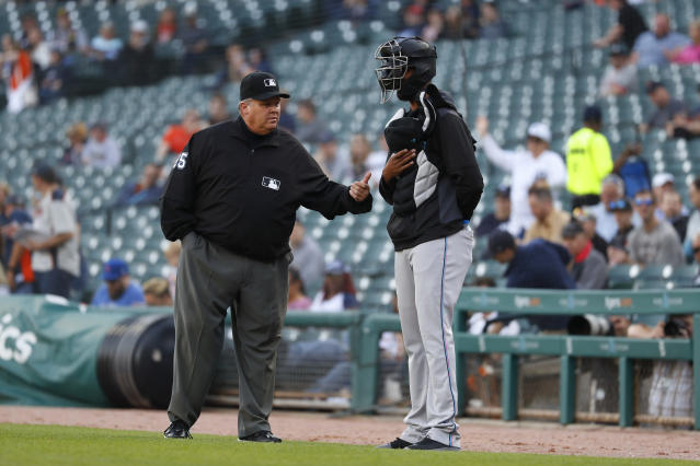 CORRECTS UMPIRE TO FIELDIN CULBRETH, INSTEAD OF D.J. REYBURN - Umpire Fieldin Culbreth tells Miami Marlins pitcher Sandy Alcantara to leave the field before the first pitch of the team's baseball game against the Detroit Tigers in Detroit, Wednesday, May 22, 2019. Alcantara stood with equipment on after national anthem until he was asked to leave the field. (AP Photo/Paul Sancya)