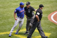 New York Mets manager Luis Rojas, left, is separated from umpire Jeremy Riggs (112) by umpire crew chief Larry Vanover, center, during the first inning of a baseball game against the Pittsburgh Pirates in Pittsburgh, Sunday, July 18, 2021. (AP Photo/Gene J. Puskar)