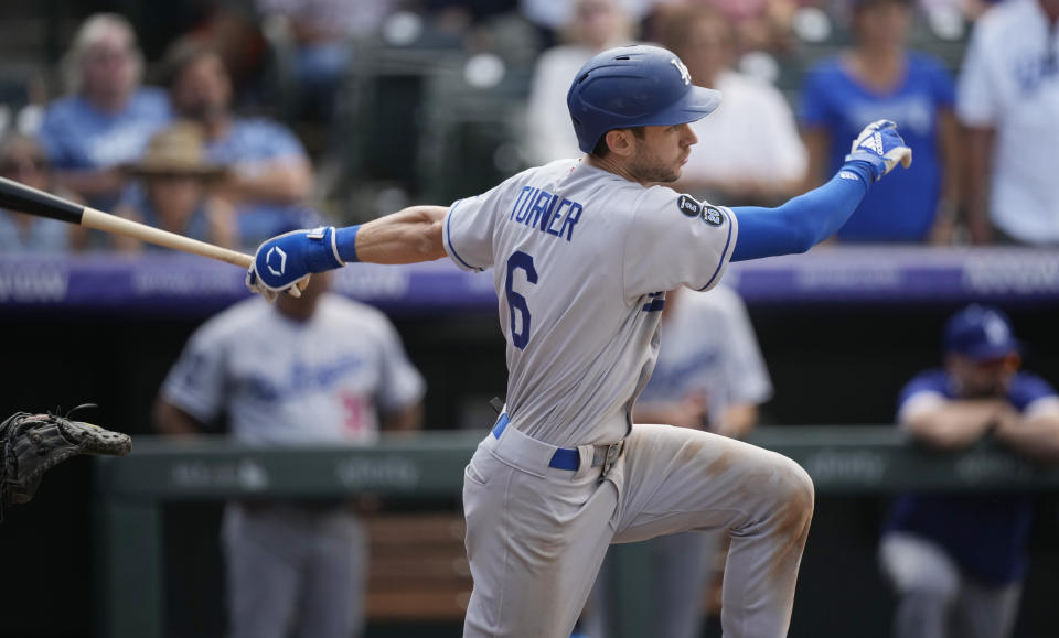 Los Angeles Dodgers' Trea Turner follows the flight of his RBI-single off Colorado Rockies relief pitcher Carlos Estevez in the ninth inning of a baseball game Thursday, Sept. 23, 2021, in Denver. (AP Photo/David Zalubowski)