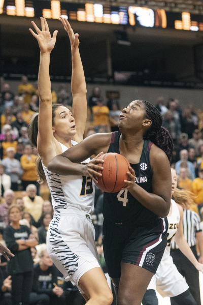 South Carolina's Aliyah Boston, right, shoots past Missouri's Hannah Schuchts, left, during the first half of an NCAA college basketball game Thursday, Jan. 16, 2020, in Columbia, Mo. (AP Photo/L.G. Patterson)