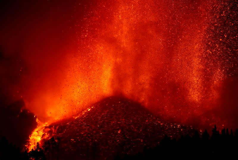 Lava rises downhill following the eruption of a volcano in Spain