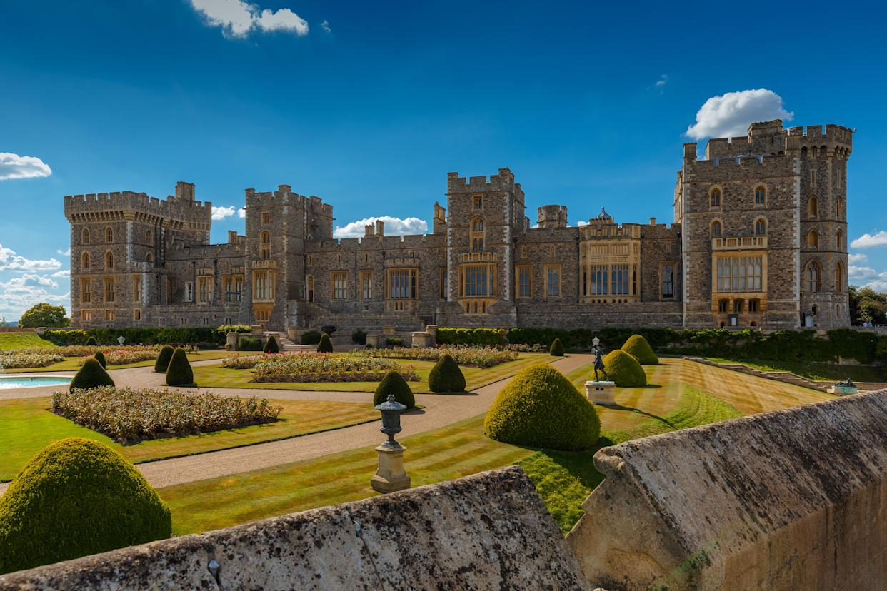 A wide view of the medieval Windsor Castle and gardens bathed in glorious sunny weather