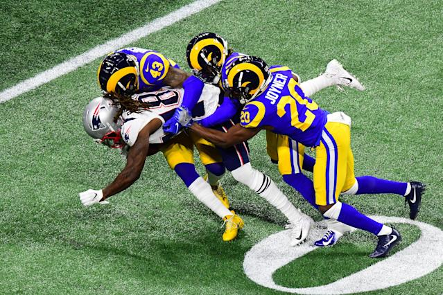 <p>John Johnson #43, Nickell Robey-Coleman #23, and Lamarcus Joyner #20 of the Los Angeles Rams tackle Cordarrelle Patterson #84 of the New England Patriots in the first quarter during Super Bowl LIII at Mercedes-Benz Stadium on February 03, 2019 in Atlanta, Georgia. (Photo by Scott Cunningham/Getty Images) </p>