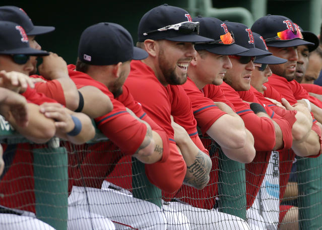 Boston Red Sox pitcher Anthony Ranaudo, center, watchs pregame events with teammates before an exhibition baseball game against Northeastern, Thursday, Feb. 27, 2014, in Fort Myers, Fla. (AP Photo/Steven Senne)