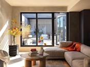 """<p>When we think of fall, yellow and orange quickly come to mind, but you only need splashes throughout. This <a href=""""https://www.elledecor.com/design-decorate/house-interiors/a35348926/re-ad-architecture-harlem-apartment/"""" rel=""""nofollow noopener"""" target=""""_blank"""" data-ylk=""""slk:Harlem bachelor pad"""" class=""""link rapid-noclick-resp"""">Harlem bachelor pad</a> achieves a transitional look with bright citrus-colored flowers and an orange throw.<br><br></p>"""