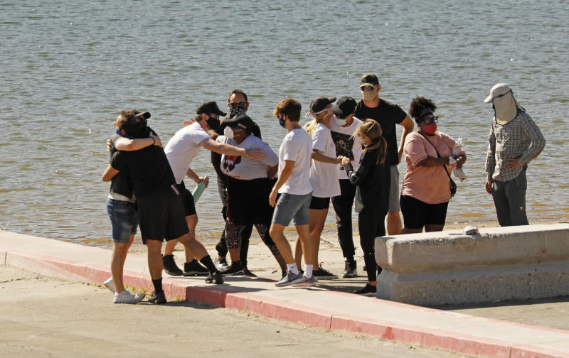 PIRU, CA - JULY 13: Cast members from the TV Show Glee and friends comfort each other as they gathered on the Lake Piru boat launch Monday morning just as Ventura County Sheriffs Search and Rescue dive team located a body Monday morning in Lake Piru as the search continued for 33-year-old Glee actress Naya Rivera after her 4-year-old son was found alone on a boat she rented last Wednesday. Rivera rented the pontoon boat and had been swimming with her son who was the last one to see her before she went missing. The boy got back into the boat after a swim but his mother did not follow. Lake Piru on Monday, July 13, 2020 in Piru, CA. (Al Seib / Los Angeles Times via Getty Images)