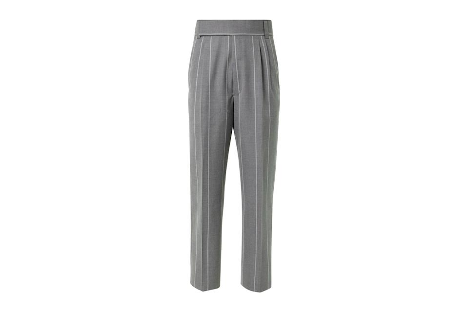 "$1145, Mr Porter. <a href=""https://www.mrporter.com/en-us/mens/product/fear-of-god-for-ermenegildo-zegna/clothing/formal-trousers/tapered-pleated-striped-melange-wool-twill-trousers/23471478576303027"" rel=""nofollow noopener"" target=""_blank"" data-ylk=""slk:Get it now!"" class=""link rapid-noclick-resp"">Get it now!</a>"