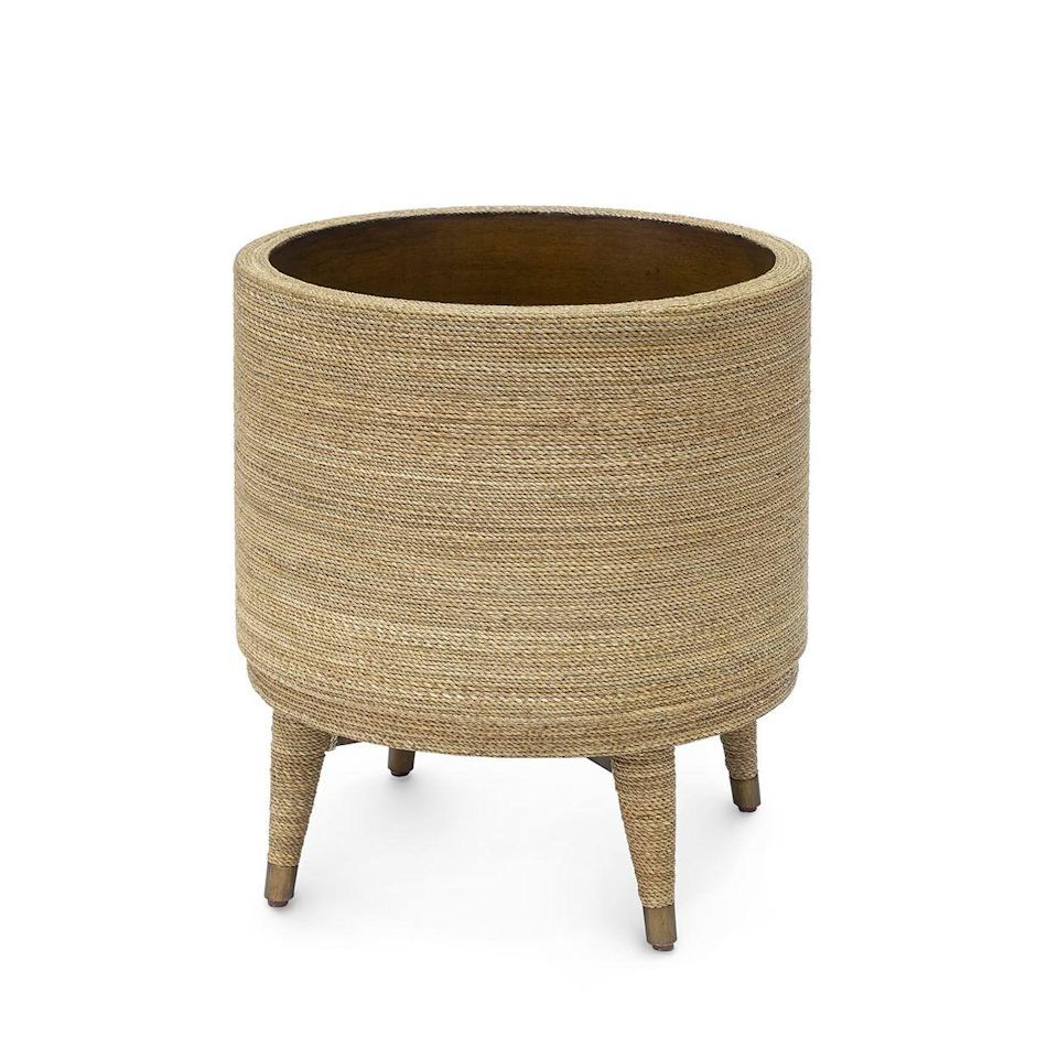 """<p><strong>natural</strong></p><p>mecox.com</p><p><strong>$775.00</strong></p><p><a href=""""https://mecox.com/shop/art-and-decor/accessories/natural-rattan-woven-planter/"""" rel=""""nofollow noopener"""" target=""""_blank"""" data-ylk=""""slk:BUY NOW"""" class=""""link rapid-noclick-resp"""">BUY NOW</a></p><p>Legs give your plant a little lift, while rattan woven all the way around the planter gives your space more texture and warmth. </p>"""
