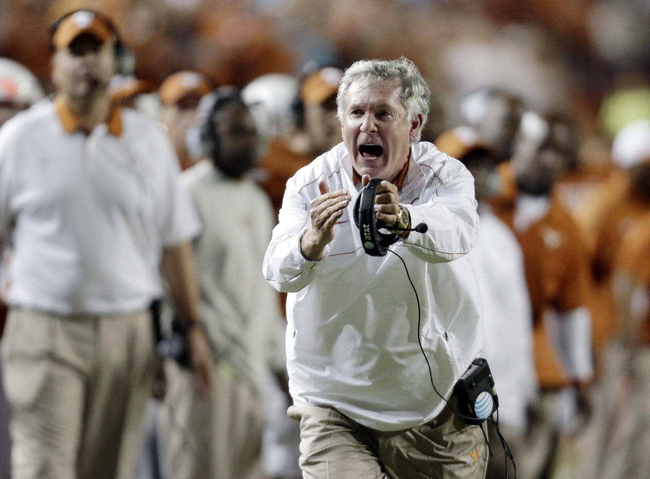 FILE - In this Oct. 6, 2012, file photo, Texas coach Mack Brown calls for a timeout during the third quarter of an NCAA college football game against West Virginia in Austin, Texas. Brown has stepped down as coach and that the Alamo Bowl against Oregon on Dec. 30 will be his last game with the Longhorns, the school announced Saturday, Dec. 14, 2013. (AP Photo/ Eric Gay, File)