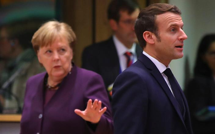 Angela Merkel hinted at growing tensions over Brexit as France warned its fishermen could not be sidelined. - AP