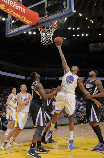 OAKLAND, CA - MARCH 24: Jeremy Tyler #3 of the Golden State Warriors shoots against Tyreke Evans #13 of the Sacramento Kings on March 24, 2012 at Oracle Arena in Oakland, California. (Photo by Rocky Widner/NBAE via Getty Images)