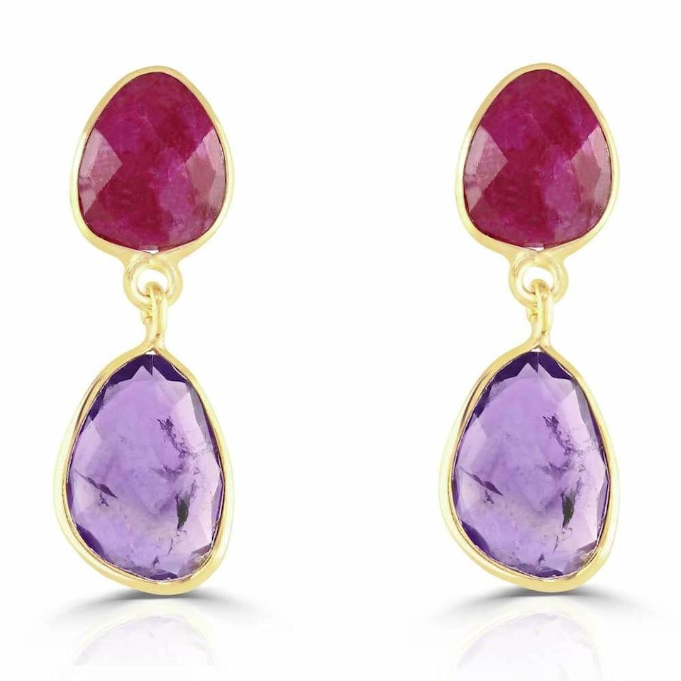"""<p><a class=""""link rapid-noclick-resp"""" href=""""https://samijewellery.com/products/jamun-amethyst-and-ruby-gem-stone-earrings-india"""" rel=""""nofollow noopener"""" target=""""_blank"""" data-ylk=""""slk:SHOP NOW"""">SHOP NOW</a></p><p> These juicy-hued earrings will bring a splash of colour to any everyday outfit. </p><p>Amethyst and ruby earrings, £140, <a href=""""https://samijewellery.com/"""" rel=""""nofollow noopener"""" target=""""_blank"""" data-ylk=""""slk:Sami"""" class=""""link rapid-noclick-resp"""">Sami </a></p>"""