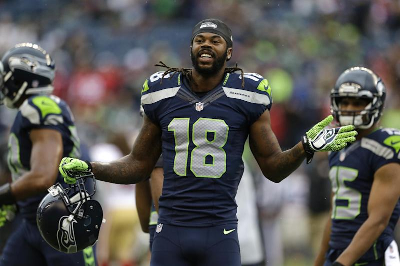 Seattle Seahawks wide receiver Sidney Rice holds his helmet as he stands on the field during warmups before an NFL football game against the San Francisco 49ers, Sunday, Sept. 15, 2013, in Seattle. (AP Photo/Elaine Thompson)