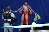 <p>Team China's Hongchan Quan gets lifted up in the air after winning gold in the Women's 10m Platform Final at Tokyo Aquatics Centre on August 5.</p>