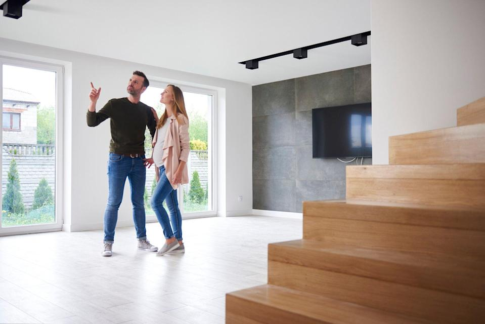 Couple looking around their new home. Source: Getty