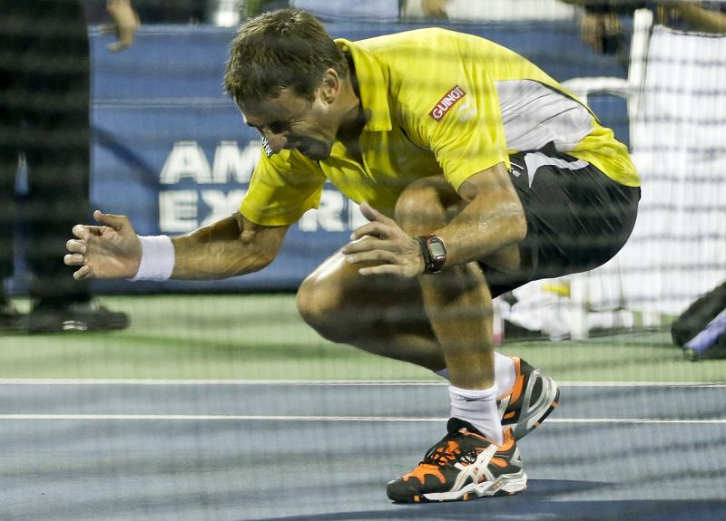 Tommy Robredo, of Spain, reacts after winning a fourth round match against Roger Federer, of Switzerland, during the 2013 U.S. Open tennis tournament, Monday, Sept. 2, 2013, in New York. (AP Photo/Darron Cummings)