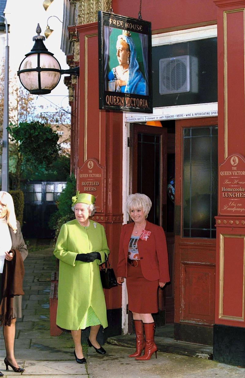 Showing the Queen around the 'EastEnders' set in 2001.