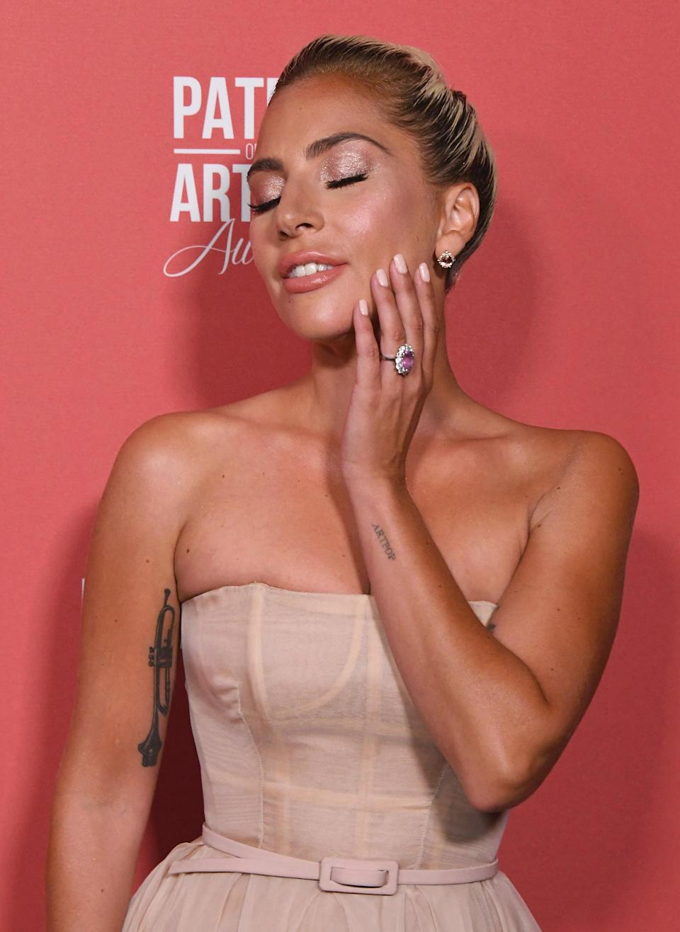 Lady Gaga posed with her engagement ring at the SAG-AFTRA Foundation's 3rd Annual Patron Of The Artists Awards in November 2018 [Photo: Getty]