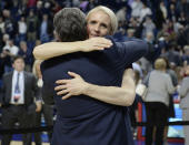 FILE - In this March 28, 2016, file photo, Connecticut assistant coach Shea Ralph embraces coach Geno Auriemma after UConn defeated Texas in the regional final of the women's NCAA basketball tournament in Bridgeport, Conn. Vanderbilt has hired Shea Ralph away from UConn to help revive the Commodores' struggling women's basketball program. Athletic director Candice Lee announced the hiring Tuesday morning, April 13, 2021, a week after firing Stephanie White. (AP Photo/Jessica Hill, File)